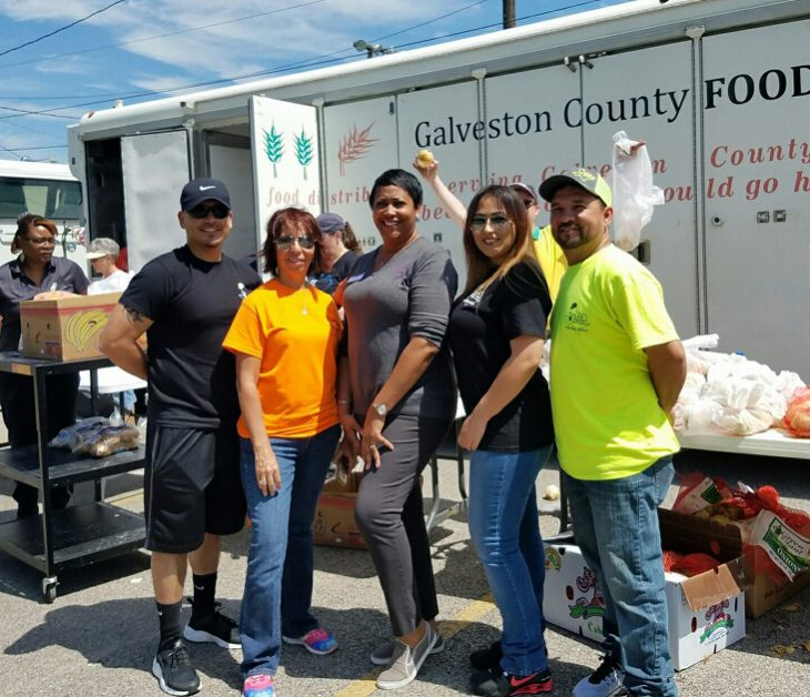 Nicole (Center) Volunteering at Galveston Food Bank with Safety Team Partners, Texas Regional Safety Services